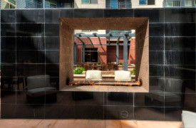 Mixed-use multifamily apartment building outdoor fireplace