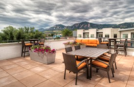 Mixed-use multifamily apartment building rooftop deck