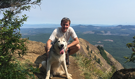 Wade Hanson hiking with husky dog in Oregon